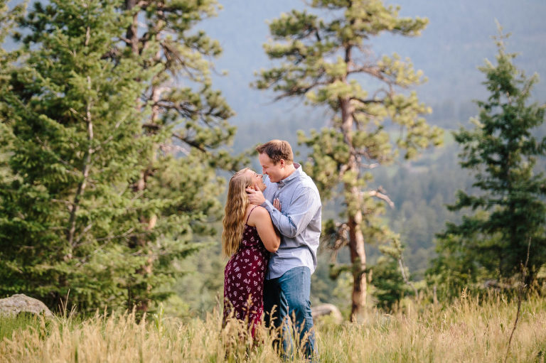 Rocky Mountain Morrison engagement, laughing couple in the mountains