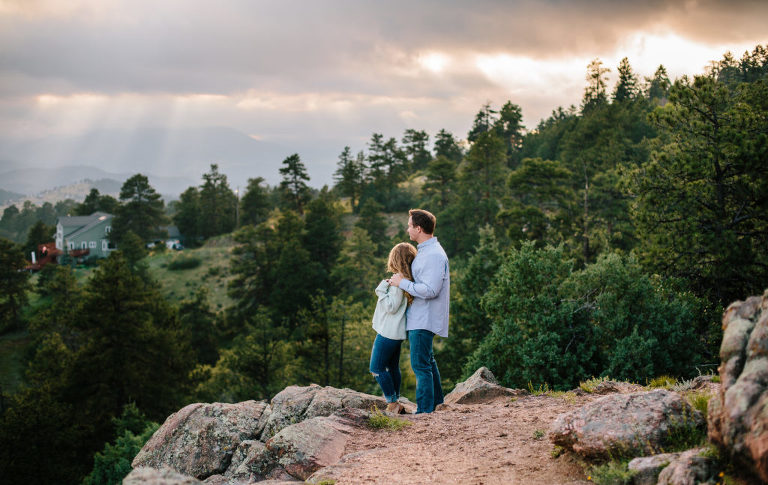 Morrison Engagement session, Mount Falcon engagement session, Mount Falcon couple looking at sunset, Mount Falcon sunset
