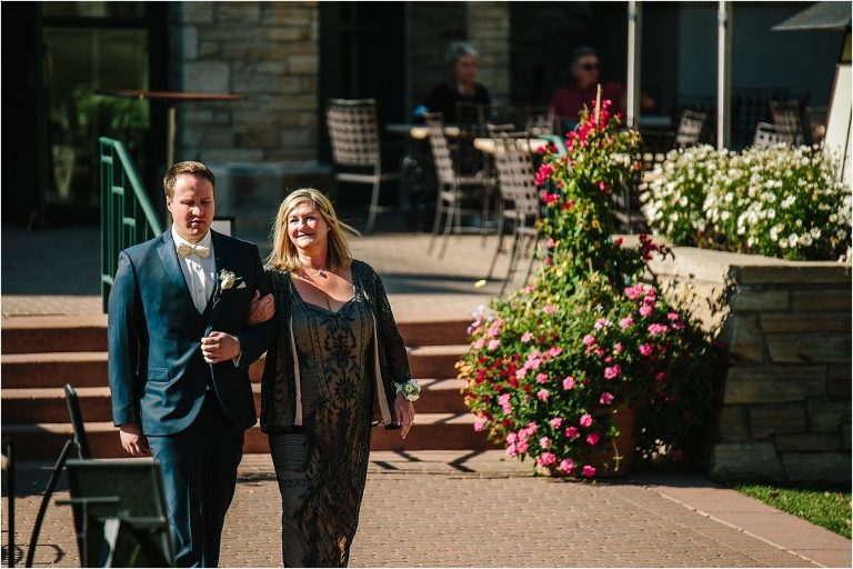 Vail wedding photographer, Vail wedding videographer, Groom walking Mom to seat, Park Hyatt at Beaver Creek wedding